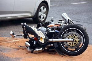 motorbike accident on the city street and the car tire