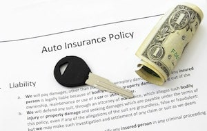 Auto Insurance Policy, Car Keys and Dollar