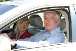 Elderly Couple Driving
