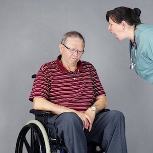 Woman Yelling to a Elderly Person